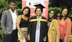 Master of Business and Administration graduate Ms Thembekile Ndlovu with her family.
