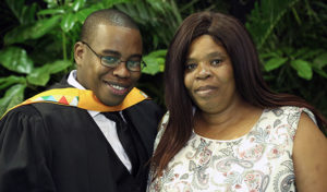 Master of Commerce in Economics graduate and scholarship recipient, Mr Doctor Sangweni with his mom, Ms Basho Sangweni.