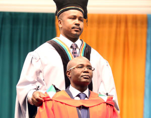 Dr Cliford Madondo being hooded by Mr Fanle Sibisi.